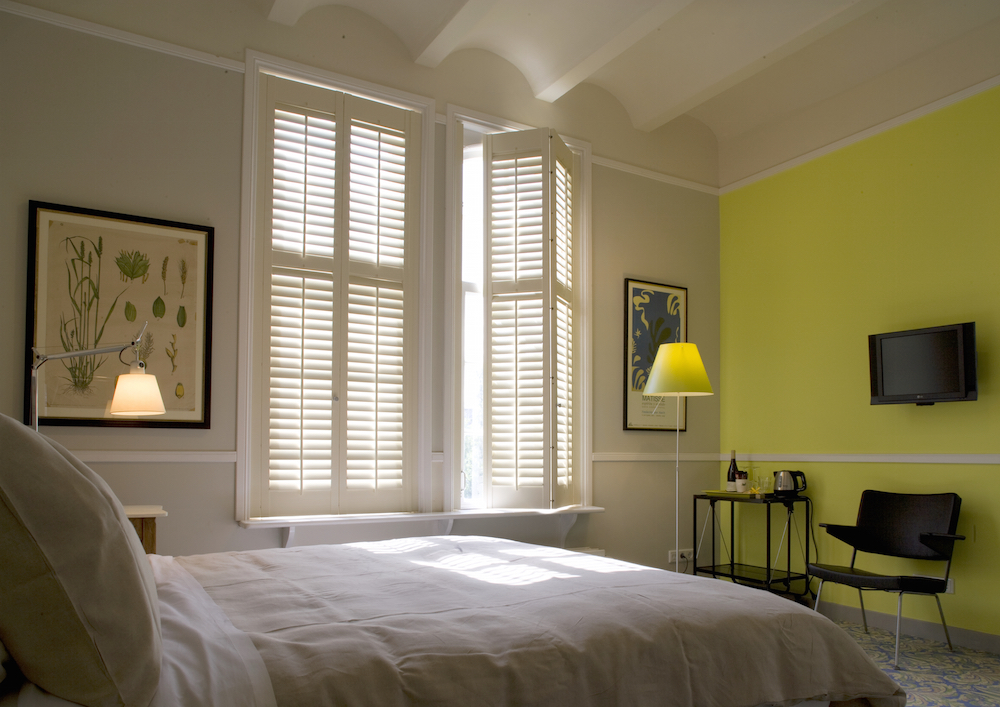 Blackout plantation shutters installed in the bedroom