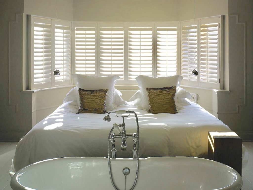 Plantation shutters installed in the bathroom